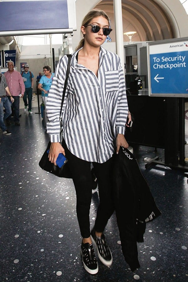 gigi-hadid-airport-outfit-in-striped-shirt Outfits with Striped Shirts-10 Ways to Wear Striped Shirts