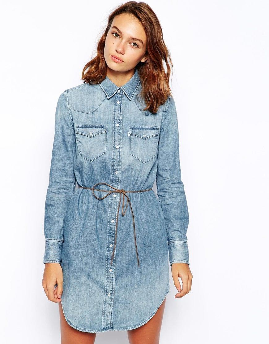 "Super cute women's Burberry Brit denim button up belted dress. It is missing a button on the left sleeve cuff. Measures 17"" from underarm to underarm and 30 1/2"" from shoulder seam to hem. % cotton."