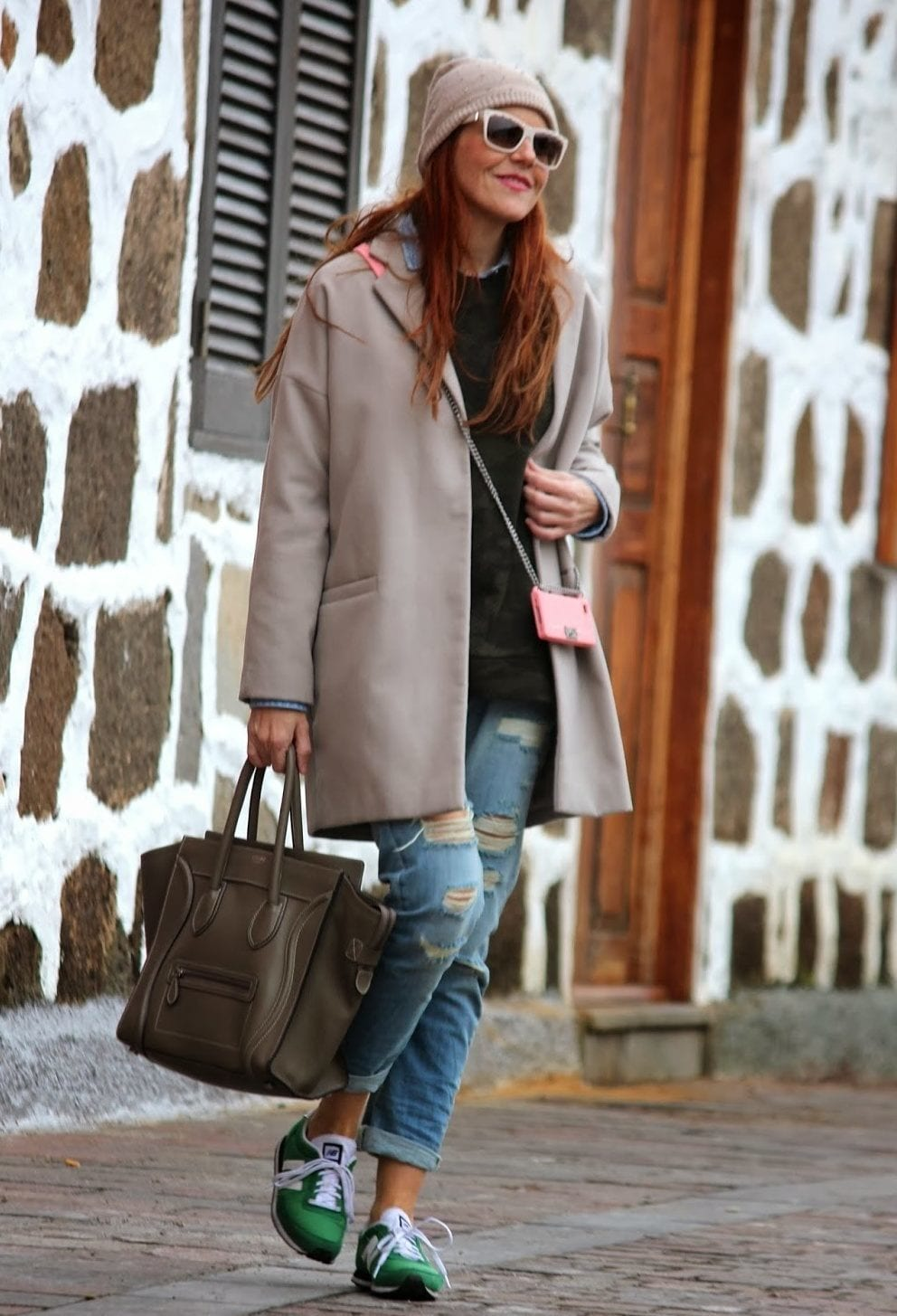 long coat with ripped jeans