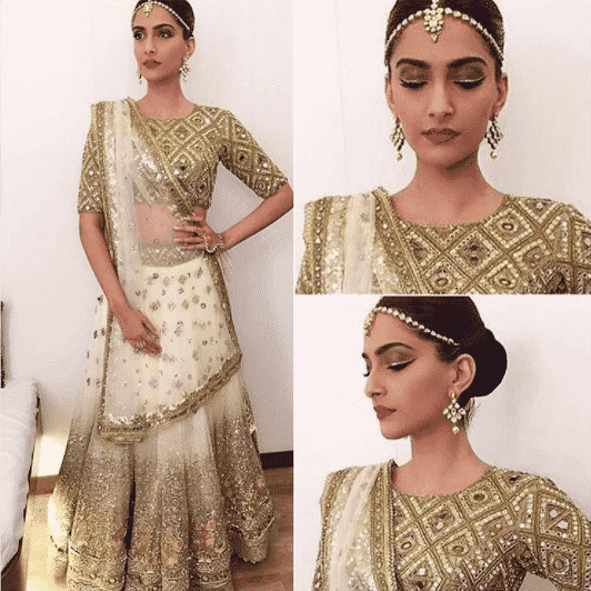 sonam-kapoor-chignon-hairstyle-with-maathapatti 16 Cute Hairstyles with Maang tikka/Maatha Patti This Season