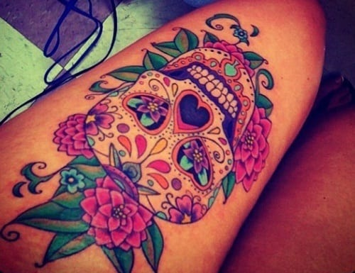 sugar-skull-with-flowers-thigh-tattoos Thigh Tattoo Ideas-20 Famous Tattoo Designs for Thighs