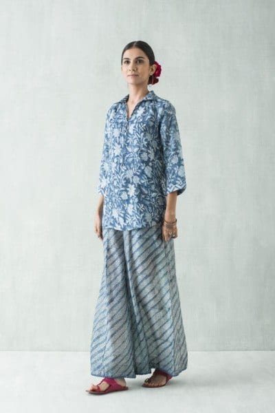 Floral-Blue-Top-With-a-Printed-Palazzo-Outfit-In-Matching-Colors 20 Outfit Ideas to Wear Short Shirts with Palazzo Pants