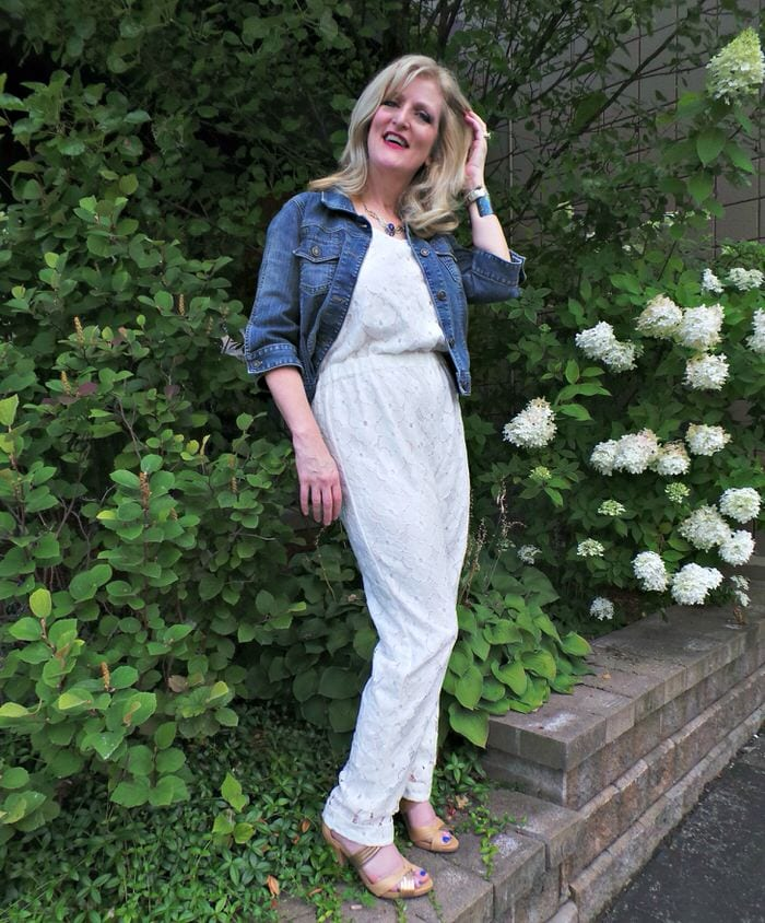 white-jumpsuit-and-denim-jacket 30 Best Summer Outfits for Women Above 50 - Style Tips