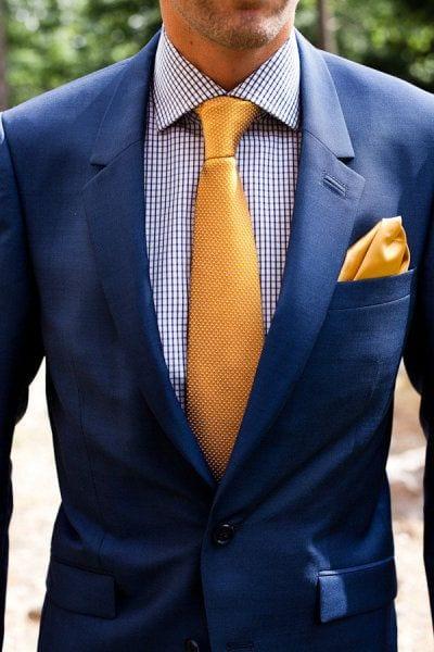 suite with contrast tie